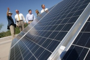 Utilities, Politicians Point To Region's Solar Future  : Randy Metcalf/EXPLORER -- City of Tucson energy manager Doug Crockett explins to Mayor Bob Walkup about the new aray of solar panels.