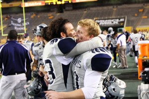 Ironwood Ridge Wins Division II State Football: Devon Olivarez celebrates with teammate Drew Yaglowski.  - J