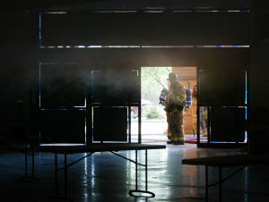 Big Box Store Fire Training: A Northwest Fire District firefighter runs through a big box store fire exercise. - Randy Metcalf/The Explorer