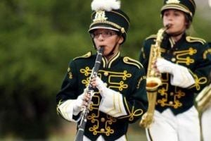 Band Competition: In this file photo, Alexandria Mercer, left, and Emily McSherry, right, of the Canyon del Oro High School marching band play and march.