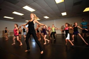 Tucson Dance Academy: Tucson Dance Academy instructor Carly Booth leads the girls in a routine she taught them during the ballroom workshop. - J.D. Fitzgerald/The Explorer