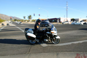 HiVE Deployment: Oro Valley motor officer Greg Burgess travels after a vehicle that rode on the the shoulder of Oracle Road to turn onto Magee Road during the department's High Visibility Enforcement deployment last week. - Randy Metcalf/The Explorer