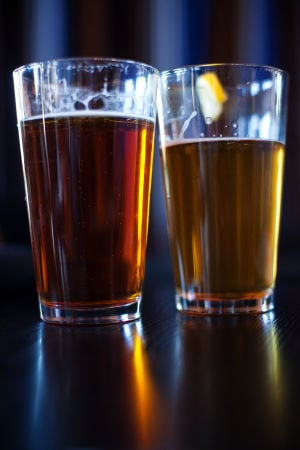Noble Hops: Two of Noble Hops' draft beers, theRubicon Irish Red andSleepy Dog Leg Humper.  - J.D. Fitzgerald/The Explorer