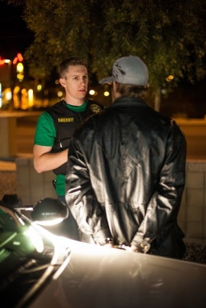 HIOP: An unnamed Pima County Sheriff Deputy interrogates a suspect from a traffic stop conducted by the High Impact Offender Program. When searched, the deputies found drug paraphernalia.  - J.D. Fitzgerald/The Explorer