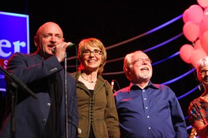 Gabrielle Giffords: Mark Kelly and Gabrielle Giffords make an appearance during a campaign rally for Ron Barber at the Rialto Theater Saturday night.  - Randy Metcalf/The Explorer