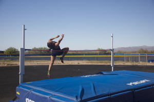 MHS Track: Sydney Madrid, a junior on the Marana High School track team flies over the high jump. Madrid won the event.  - Hannah McLeod/The Explorer