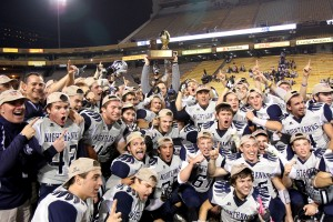 Ironwood Ridge Wins Division II State Football: As Coach Matt Johnson hoists the trophy high, the enter Nighthawks' team celebrates around him.  - Jon Grimes/Special to the Explor