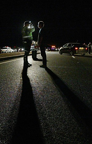 DUI Checkpoint: Pima County Sheriff Deputy Richard Carlson administers a field sobriety test to an individual who showed signs of driving under the influence of alcohol. - Randy Metcalf/The Explorer