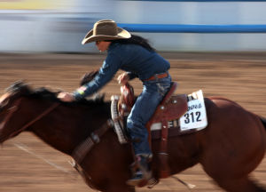 Fiesta De Los Vaqueros: Sarah Kieckhefer or Prescott, Ariz. races towards the finish line for a time of 17.53 during the women's barrel racing event.  - Randy Metcalf/The Explorer