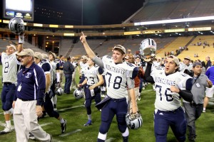 Ironwood Ridge Wins Division II State Football: Michel Cism and Trevor Eischeid rush the field after the final play.  - Jon Grimes/Special to the Explor