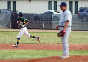 Canyon Del Oro Vs Ironwood Ridge Baseball: CDO's Brandon Burke makes his way around the bases after hitting a shot over the left field fence.  - Randy Metcalf/The Explorer