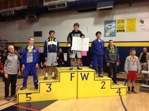 Bailey Janis: Bailey Janis, senior wrestler at Mt. View High School stands on the podium after winning first at Flowing Wells High School. Janis recently won his second individual state championship at Tim's Toyota Center in Prescott.  - Courtesy of Rick Majalca