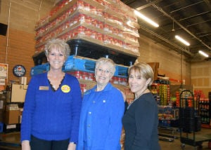 Peanut Butter Donation: From left to right are Vicki Sibley, Fry's Food Store #689 manager, Linda Hampton, Marana Community Food Bank executive director and Romi Carrell Wittman, director of communications for TRICO Electric Power Cooperative, Inc.
