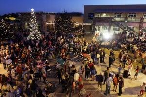Marana Holiday Tree Lighting: People gather around at the Marana Christmas Tree is ceremoniously lit Saturday night.  - Randy Metcalf/The Explorer