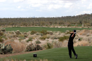 Accenture Match Play Championship: Tiger Woods tees off on the fifth hole Thursday.  - Randy Metcalf/The Explorer