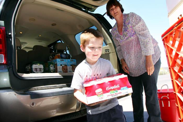 Boy, 4, collects food instead of presents