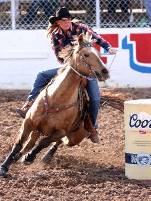 Fiesta De Los Vaqueros: Danna Strovner from Prineville, Ore. finishes the women's barrel racing event with a time of 17.58.  - Randy Metcalf/The Explorer