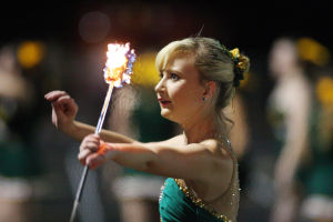 Hannah Johnson: CDO freshman Hannah Johnson twirls a flaming baton on the sidelines during a home football game earlier in the school year.  - Randy Metcalf/The Explorer