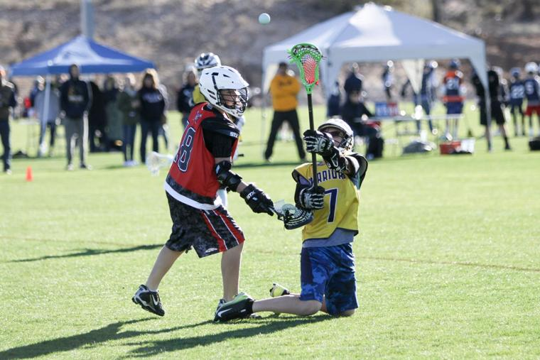 Oro Valley Lacrosse Club 12U - pass from the knee.jpg