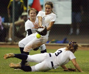 Ironwood Ridge Vs Canyon Del Oro Softball: After a shot to the outfield by Canyon Del Oro senior Briana Dohogne, Ironwood Ridge's left fielder Jordan Rocker, left, shortstop Erin Satterfield, center, and right fielder Merrilee Miller, right, come together trying to catch the ball.  - Randy Metcalf/The Explorer