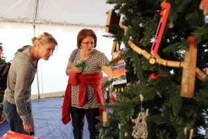 Oro Valley Holiday Tree Lighting: Cindy Baker, right, and Kristen Baker look at one of the many Christmas trees that were decorated for the Oro Valley Annual Holiday Tree Lighting Celebration.  - Randy Metcalf/The Explorer