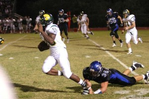 CDO Rumbles To Win At Foothills : Randy Metcalf/The Explorer, Catalina Foothills' linebacker Ernie Escarcega trips up Canyon del Oro's Ka'Deem Carey in the second quarter of Friday night's game. Carey left the game after the play with an injury, and did not return.