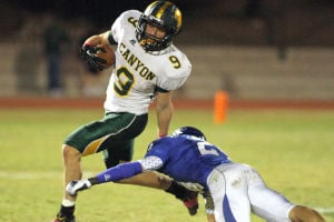 Canyon Del Oro Vs Catalina Foothills Football: Canyon Del Oro's Max Smith breaks to the outside to avoid a Catalina Foothills defender during Friday night's game. The Dorados beat the Falcons 19-12. - Randy Metcalf/The Explorer