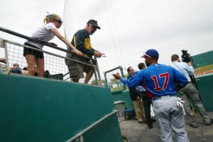 Spring Training: Cubs' right fielder Dave Sappelt signs a few autographs for fans as he makes his way onto the field last Thursday in Tucson.  - Randy Metcalf/The Explorer