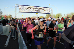 Arizona Distance Classic: Katie Rutterer, center, starts out on running the Arizona Distance Classic half marathon. More than 900 runners entered to run in the race Sunday, in addition to the runners who ran in the quarter marathon and the 5K race.  - Randy Metcalf/The Explorer