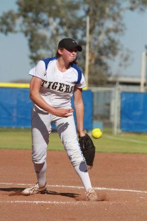 Marana Vs Desert Ridge Softball: Casey Cadenhead sends a pitch across the plate.  - Randy Metcalf/The Explorer