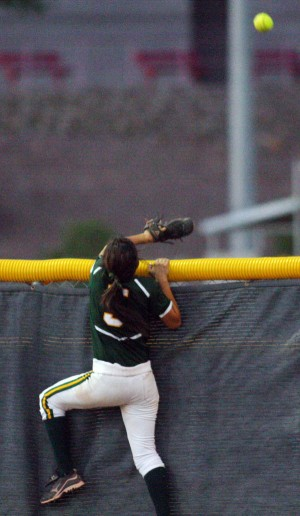 Ironwood Ridge Vs Canyon Del Oro Softball: CDO's Monique Castillo goes after a ball hit over the fence by Ironwood Ridge's Robyn Porter.  - Randy Metcalf/The Explorer