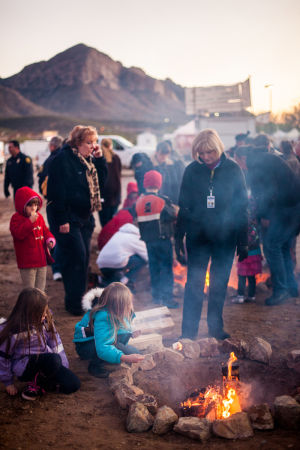 Oro Valley Holiday Tree Lighting Celebration: Mini campfires were setup for roasting marshmallows at the Oro Valley Holiday Tree Lighting Celebration. - J.D. Fitzgerald/The Explorer