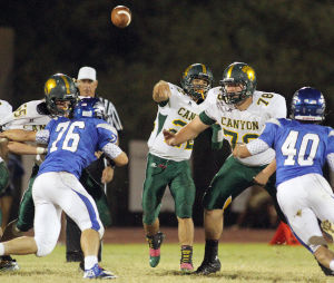 Canyon Del Oro Vs Catalina Foothills Football: Dorado quarterback Jordan Closs-Lopez throws a pass deep down the field to Thomas Sawyer, who ran it in for a touchdown. - Randy Metcalf/The Explorer