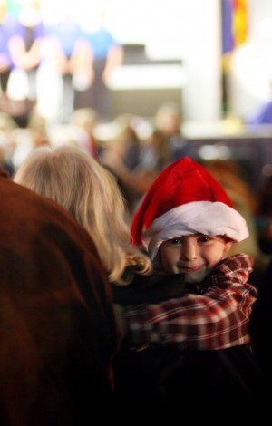 Oro Valley Holiday Tree Lighting: Noah Davis, 3, is held by his grandmother Linda Davis during one of the concerts performed during the Oro Valley Annual Holiday Tree Lighting Celebration.  - Randy Metcalf/The Explorer