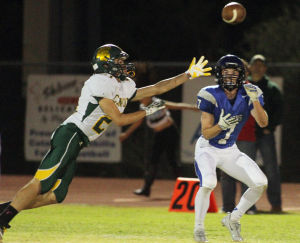 Canyon Del Oro Vs Catalina Foothills Football: Canyon Del Oro's Edward Contreras tries to get his hands on a pass intended for a Catalina Foothills receiver. - Randy Metcalf/The Explorer