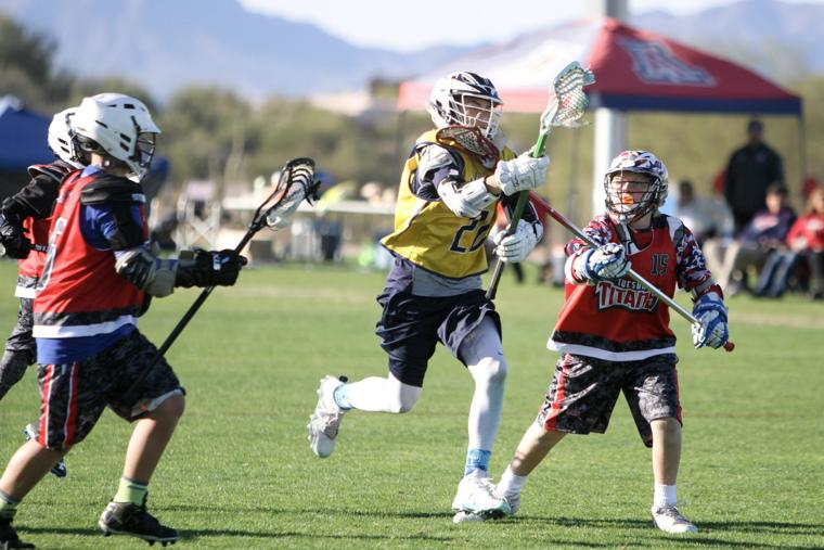 Oro Valley Lacrosse Club 12U - stick to the face.jpg