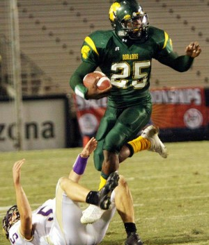State Champs : Randy Metcalf/The Exlorer, Canyon Del Oro's Dorados football team, led by the superlative skills of Ka'Deem Carey and buttressed by a strong core of senior leaders, handily defeated Sabino 40-0 Saturday to claim the school's first state championship in more than 30 years.