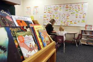Volunteers teach reading, 1-on-1