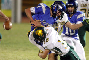 Canyon Del Oro Vs Catalina Foothills Football: Zachary Unger forces a fumbled on the Falcon's ball carrier. - Randy Metcalf/The Explorer
