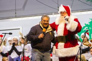 Oro Valley Holiday Tree Lighting Celebration: Oro Valley mayor Satish Hiremath welcomes Santa Claus at the Oro Valley 14th Annual Holiday Tree Lighting Celebration. - J.D. Fitzgerald/The Explorer