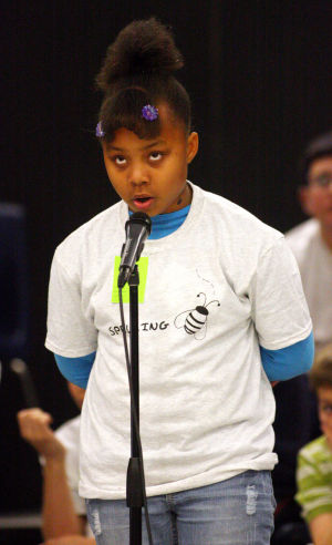 Amphitheater School District Spelling Bee: Corrin Elem, a La Cima Middle School student, thinks about her word during the Amphitheater School District's spelling bee last week.  - Randy Metcalf/The Explorer