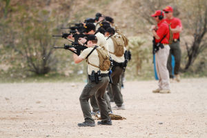 Sheriff's Academy: Pima County Sheriff recruits practice their shooting skills on a closed course over the watchful eye of instructors at the Sheriff's Department Basic Law Enforcement Training Academy.  - J.D. Fitzgerald/The Explorer