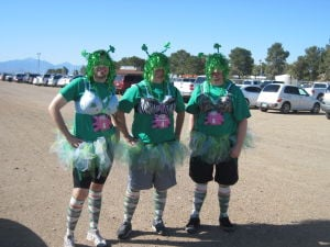 "Kiss Me Dirty Race Series: Explorer Production Manager Brandon Hays, Logan Garland and Peter Mangan donned ""ChickSuits"" to participate in the iKss Me Dirty mud run in Tucson on March 17.  - courtesy photo"