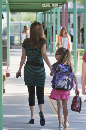 First Day Of School: Kristi Karlik and her 7-year-old daughter Makenna make their way to Makenna's second-grade classroom. - Randy Metcalf/The Explorer