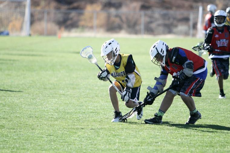 Oro Valley Lacrosse Club 12U - picking up the ball.jpg