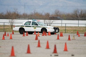 Sheriff's Academy: Recruit officers drove patrol cars in a simulated pursuit course during the Sheriff's Department Basic Law Enforcement Training Academy.  - J.D. Fitzgerald/The Explorer