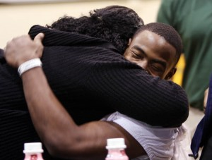 NW Students Sign Letters-of-intent 4: Ka'Deem Carey gets a big hug from his mother Tisha McKinney after she found out her son chose to play football for the University of Arizona.  - Randy Metcalf/The Explorer