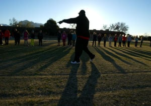 Olympic Medalist Michael Bates: 1992 Olympic bronze medalist Michael Bates leads an exercise at Mesa Verde Elementary School last week. Bates, who played in the NFL and was an Olympic sprinter, went through basic drills to prepare them for an upcoming track meet.  - Randy Metcalf/The Explorer