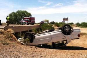 Northwest Fire Extracting Rollover Victim On Frontage Road: Northwest fire crews are on the scene of a vehicle rollover between the Tangerine and Marana exits on the westbound frontage road. - Adam Goldberg