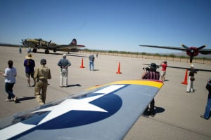 Wings Of Freedom Tour: For the Wings of Freedom Tour in Marana put on by the Collings Foundation, the B24, left, B17, right, and P51 Mustang are readied for the weekend. The tour travels the nation a flying tribute to the flight crews who flew them, the ground crews who maintained them, the workers who built them, the soldiers, sailors and airmen they helped protect; and the citizens and families that share the freedom that they helped preserve.  - Randy Metcalf/The Explorer